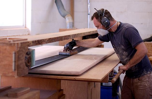 Shop-built stroke sander in use sanding a Mitchell table top